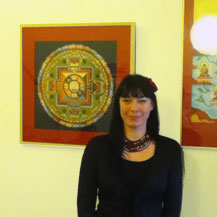 Carmen Mensink in front of her mandala of the Buddha of compassion, Amsterdam, 2011