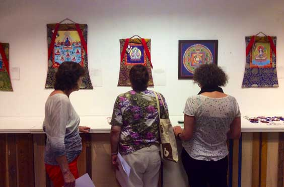 Art lovers looking at the artworks by Carmen Mensink at her thangka exhibition